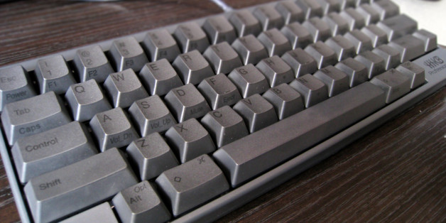 """My new <a href=""""http://en.wikipedia.org/wiki/Happy_Hacking_Keyboard"""">Happy Hacking Keyboard Professional 2</a>, imported from Japan.  I do look at the keys occasionally (thankfully, with black labels on black keys, it's not much), so I needed labels. Also, labels are vital because of so many keys that are in non-standard places and only available through the function key.  The keys have a roughened texture (not a camera artifact). For some reasons, Topre-based HH keyboards don't photograph well.  Color adjustment with GIMP, and depth-of-field effect added with Focus Blur filter."""