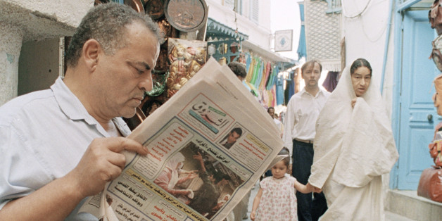 An unidentified Tunisian reads news of the ongoing meetings of the Fatah faction of the Palestinian Liberation Organization in a local newspaper in the old part of Tunis on Sept. 3, 1993. PLO head Yasser Arafat is trying to win the approval of key Palestinian leaders for a landmark accord with Israel. (AP Photo/Francois Mori)