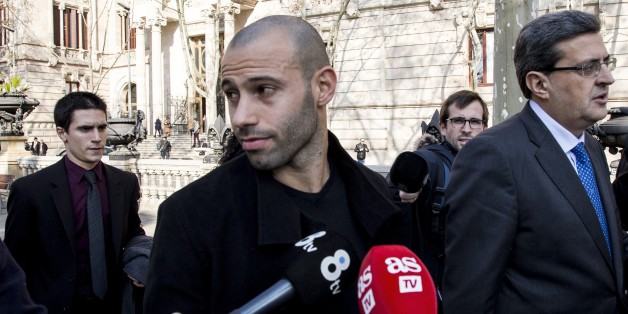 FC Barcelona's player Javier Mascherano (C) leaves the Barcelona's law court after his trial for unpaid taxes in Barcelona, Spain on January 21, 2016. (Photo by Albert Llop/Anadolu Agency/Getty Images)