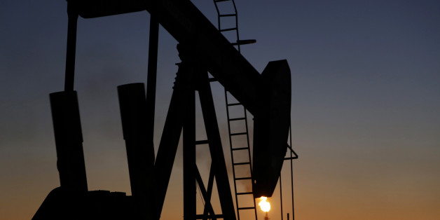 An oil pump works at sunset Monday, Jan. 18, 2016, in the desert oil fields of Sakhir, Bahrain. Iran is aiming to increase its oil production by 500,000 barrels per day now that sanctions have been lifted under a landmark nuclear deal with world powers, a top official said. (AP Photo/Hasan Jamali)