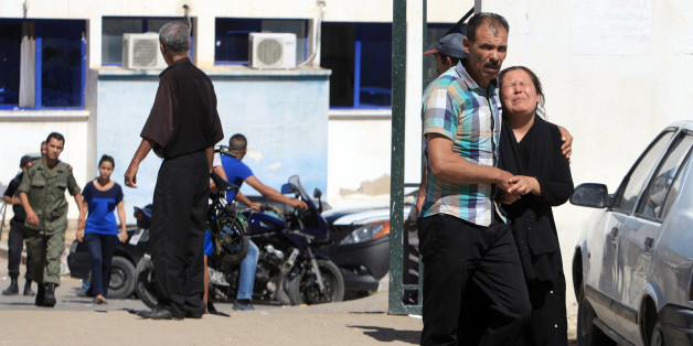 - FILE - In this July 17, 2014 file photo, a relative of a victim, right, cries outside the hospital of Kasserine, near the Algerian border, after militants in western Tunisia staged two simultaneous attacks on army posts while soldiers held a Ramadan feast. The country that kicked off the Arab Spring by overthrowing its dictator in 2011, Tunisia is also the only place where the transition to democracy is on track, even as it battles armed militants, a struggling economy and a deeply divided political class. Voters will head to the ballots on October 26, exactly three years after they put into power a moderate Islamist party. (AP Photo/ Mouldi Kraeim, File)