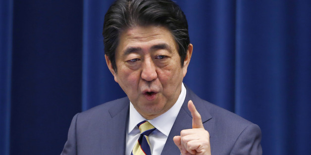 Japanese Prime Minister Shinzo Abe speaks to the media during the New Year's press conference at his official residence in Tokyo, Monday, Jan. 4, 2016. (AP Photo/Shizuo Kambayashi)