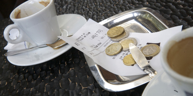 Euro coins left to pay for a coffee at a cafe