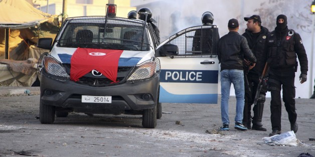 Police forces gather in the city of Ennour, near Kasserine, Tunisia, Wednesday, Jan. 20, 2016. Tunisia has declared a curfew in the western city after clashes between police and more than 1,000 young protesters demonstrating for jobs. Tensions have risen in Kasserine since Sunday when an unemployed youth killed himself by scaling an electricity transmission tower to protest his rejection for a government job. (AP Photo/Moncef Tajouri)