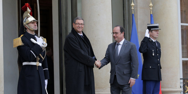 French President Francois Hollande, right,  greets Tunisian Prime Minister Habib Essid before a meeting at the Elysee Palace, in Paris, Friday, Jan. 22, 2016. (AP Photo/Christophe Ena)