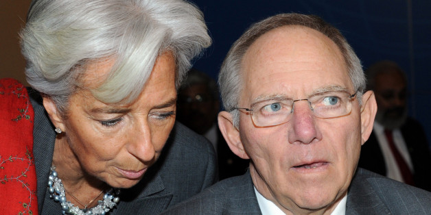 French Finance Minister Christine Lagarde, left, talks with German Finance Minister Wolfgang Schauble during the opening session of the G20 Finance summit in Paris, Saturday, Feb. 19, 2011. Finance chiefs from the world's 20 most industrialized and fastest developing nations discuss how to steady the world economy at a two-days meeting in Paris.  (AP Photo/Miguel Medina, Pool)