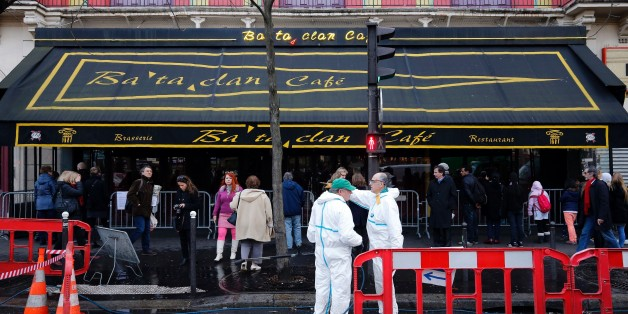 City workers clean the sidewalk and the street in front of the Bataclan concert hall in Paris on December 22, 2015, after the sidewalk in front of the venue was once again made accessable to pedestrians. A coordinated series of gun and bomb attacks at several sites in Paris on November 13, including the Bataclan concert hall, left 130 dead. / AFP / FRANCOIS GUILLOT        (Photo credit should read FRANCOIS GUILLOT/AFP/Getty Images)
