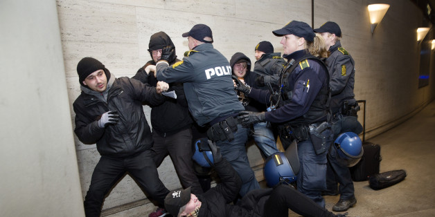 Members of 'Refugees are Welcome' react with police as they demonstrate against the Swedish control of identification from travelers and migrants, at Copenhagen International Airport in Kastrup, Denmark, Saturday, Jan. 9 2016. Sweden requires train companies offering a service across a bridge-and-tunnel link from Denmark to refuse passengers without IDs. (Thomas Borberg/ Polfoto via AP) DENMARK OUT