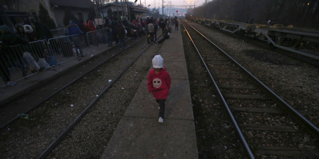 A migrant child walks along  the side of railway tracks at the railway station in the southern Serbian town of Presevo, Wednesday, Dec. 23, 2015. As 2015 ends, boat-loads continue to reach the shores of Greek islands from the nearby Turkish coast, while thousands of migrants unlikely to receive refugee status are stranded along the Balkan migrant route, their hopes of reaching the prosperous northern EU countries in jeopardy.  (AP Photo/Darko Vojinovic)