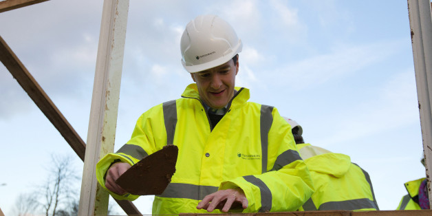 Chancellor of the Exchequer George Osborne lays bricks during a visit to a housing development in South Ockendon in Essex.