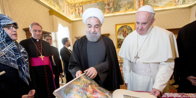 VATICAN CITY, VATICAN - JANUARY 26:  Pope Francis exchanges gifts with President of Iran Hassan Rouhani during a private audience at his private library in the Apostolic Palace on January 26, 2016 in Vatican City, Vatican.  (Photo by Vatican Pool/Getty Images)