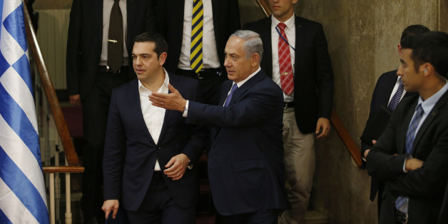 Israel's Prime Minister Benjamin Netanyahu and Greece's Prime Minister Alexis Tsipras, arrive for a press conference, in Jerusalem, Wednesday, Nov. 25, 2015. (Ronen Zvulun/Pool Photo via AP)