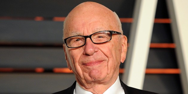 "FILE - In this Feb. 22, 2015 file photo, Rupert Murdoch arrives at the 2015 Vanity Fair Oscar Party in Beverly Hills, Calif. Murdoch, issued an apology Thursday, Oct. 8, after he faced social media backlash following his suggestion that President Barack Obama isn't a ""real black president."" (Photo by Evan Agostini/Invision/AP, FIle)"
