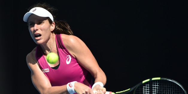 Britain's Johanna Konta plays a backhand return  during her women's singles semi-final match against Germany's Angelique Kerber on day eleven of the 2016 Australian Open tennis tournament in Melbourne on January 28, 2016. AFP PHOTO / SAEED KHAN-- IMAGE RESTRICTED TO EDITORIAL USE - STRICTLY NO COMMERCIAL USE / AFP / SAEED KHAN        (Photo credit should read SAEED KHAN/AFP/Getty Images)