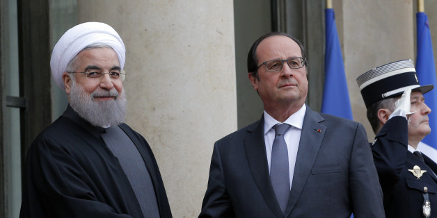 French president Francois Hollande, right,  welcomes Iranian President Hassan Rouhani before a meeting at the Elysee Palace, in Paris, Thursday, Jan. 28, 2016. France has welcomed Iranian President Hassan Rouhani with a lucrative car-making agreement and pledges to boost trade after a diplomatic deal easing nuclear tensions. (AP Photo/Christophe Ena)