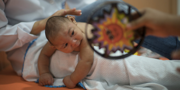 Three-month-old Daniel, who was born with microcephaly, undergoes physical therapy at the Altino Ventura foundation in Recife, Brazil, Thursday, Jan. 28, 2016. Brazilian officials still say they believe there's a sharp increase in cases of microcephaly and strongly suspect the Zika virus, which first appeared in the country last year, is to blame. The concern is strong enough that the U.S. Centers for Disease Control and Prevention this month warned pregnant women to reconsider visits to areas w