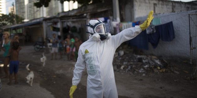 A municipal worker gestures during an operation to combat the Aedes aegypti mosquitoes that transmits the Zika virus in Recife, Pernambuco state, Brazil, Tuesday, Jan. 26, 2016. Brazil's health minister Marcelo Castro says the country is sending some 220,000 troops to battle the mosquito blamed for spreading a virus suspected of causing birth defects, but he also says the war is already being lost. (AP Photo/Felipe Dana)