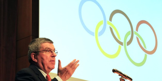 """IOC President Thomas Bach speaks during a sporting awards ceremony of Greek athletes in Athens on Wednesday, Jan. 27, 2016. Bach says he is confident the Rio Olympics will """"overwhelm"""" the world, despite the host country's major financial crisis. (AP Photo/Paris Sarrikostas)"""