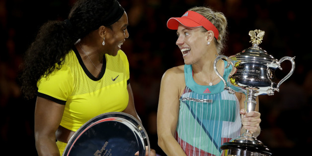 Angelique Kerber, right,  of Germany talks with Serena Williams of the United States during the awarding ceremony after winning the women's singles final at the Australian Open tennis championships in Melbourne, Australia, Saturday, Jan. 30, 2016.(AP Photo/Aaron Favila)