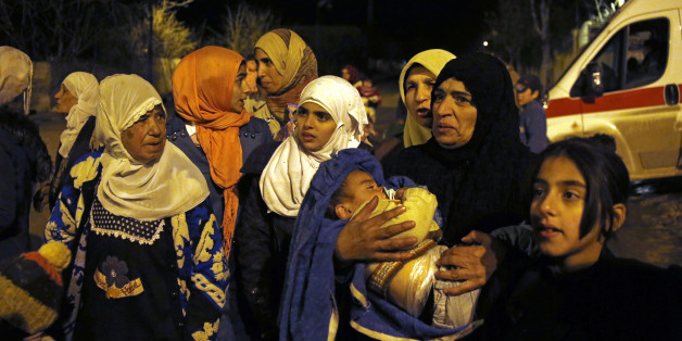 In this Monday, Jan. 11, 2016 photo, people wait to leave the besieged town of Madaya, northwest of Damascus, Syria. Aid convoys reached three besieged villages on Monday — Madaya, near Damascus, where U.N. humanitarian chief Stephen O'Brien said about 400 people need to be evacuated immediately to receive life-saving treatment for medical conditions, malnourishment and starvation, and the Shiite villages of Foua and Kfarya in northern Syria. Reports of starvation and images of emaciated ch