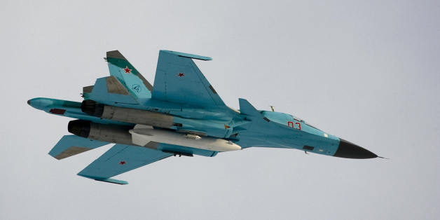 A Su-34 bomber jet with Russian President Dmitry Medvedev aboard flies over the Kubinka airfield near Moscow in Kubinka on March 28, 2009.  The white object under the jet is an external fuel tank.              AFP PHOTO / POOL / ALEXANDER ZEMLIANICHENKO (Photo credit should read ALEXANDER ZEMLIANICHENKO/AFP/Getty Images)