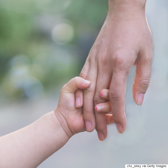 mom and child holding hands