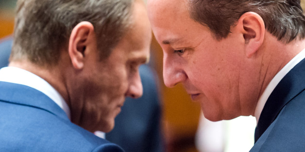 European Council President Donald Tusk, left, speaks with British Prime Minister David Cameron during a round table meeting at an EU summit in Brussels on Friday, June 26, 2015. EU leaders, in a second day of meetings, will discuss migration, the Greek bailout and European defense. (AP Photo/Geert Vanden Wijngaert)