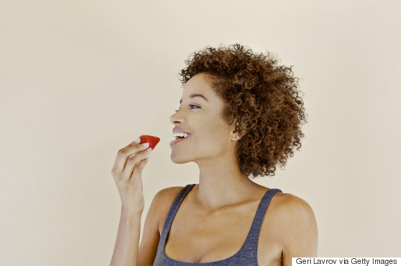 young woman eating fruit