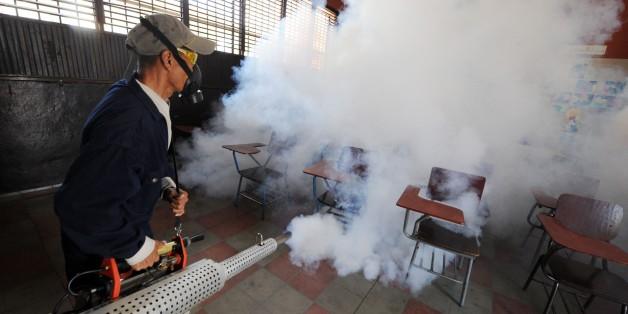 Health ministry personnel fumigate against the Aedes aegypti mosquito, vector of the dengue, Chikungunya and Zika viruses in Tegucigalpa, , on February 1, 2016. Honduran President Juan Orlando Hernandez on Friday declared the country on a preventive state of alert due to the Zika virus which in the last 44 days killed a person and infected some 1000.      AFP PHOTO/Orlando SIERRA. / AFP / ORLANDO SIERRA        (Photo credit should read ORLANDO SIERRA/AFP/Getty Images)