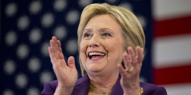 Democratic presidential candidate Hillary Clinton applauds former Arizona Rep. Gabby Giffords as she speaks at a Clinton event in Hampton, N.H., Tuesday Feb. 2, 2016, on Clinton's first day in New Hampshire after winning the Iowa Caucus. (AP Photo/Jacquelyn Martin)