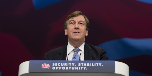 John Whittingdale, Secretary of State for Culture, Media and Sport speaks during the Conservative Party Conference, in Manchester, England, Monday Oct. 5, 2015. The ruling Conservative Party continue their annual conference on Monday, seemingly buoyant after their electoral triumph in May. (AP Photo/Jon Super)