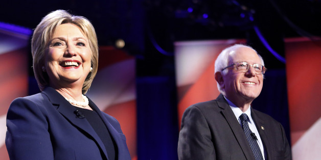 Democratic presidential candidates Hillary Clinton, left, and Sen. Bernie Sanders, I-Vt, pose for a photo before debating at the University of New Hampshire Thursday, Feb. 4, 2016, in Durham,NH (AP Photo/Jim Cole)
