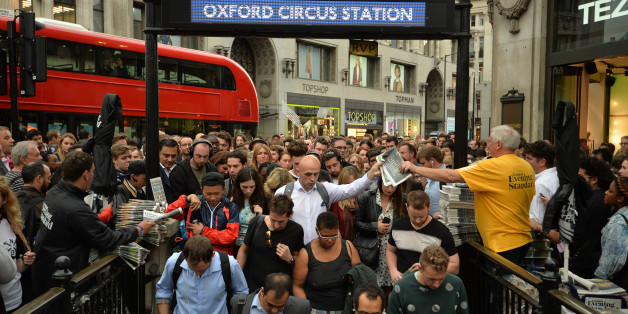 People queue at an entrance to Oxford Circus station, London, as workers try to get home before a strike by Underground workers closes the capital's entire Tube system.