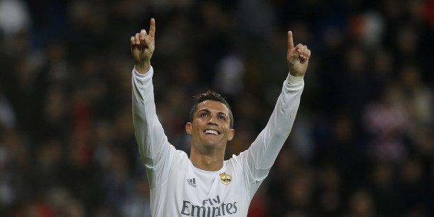 Real Madrid's Cristiano Ronaldo,left, celebrates after scoring his side's fifth goal during the Spanish La Liga soccer match between Real Madrid and Espanyol at the Santiago Bernabeu stadium in Madrid, Sunday, Jan. 31, 2016. (AP Photo/Francisco Seco)
