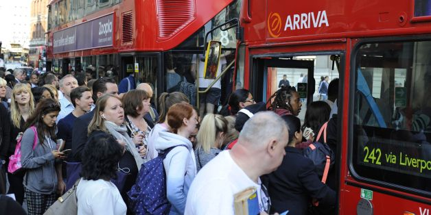 People queue for buses outside Liverpool Street Station, London, as commuters face travel misery trying to get to work because of a strike which has brought London Underground to a standstill.