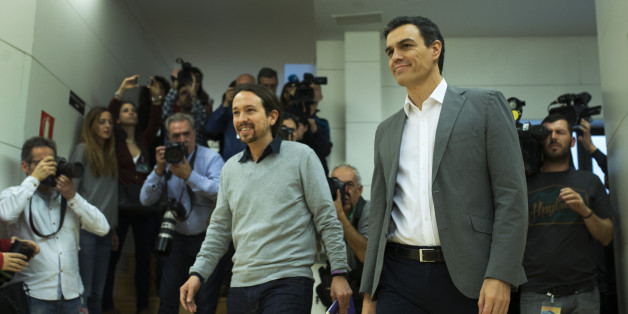 Spain's Socialist Party leader Pedro Sanchez, right, and Podemos Party leader Pablo Iglesias arrive for their meeting at the Spanish parliament in Madrid, Friday, Feb. 5, 2016. The meeting between Sanchez and Iglesias is a part of the negotiation rounds to try to form a government after elections. (AP Photo/Francisco Seco)