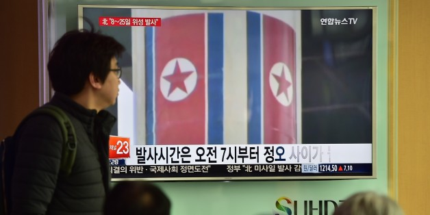 People watch a news report on North Korea's planned rocket launch as the television screen shows file footage of North Korea's Unha-3 rocket which launched in 2012, at a railway station in Seoul on February 3, 2016. North Korea announced it planned to launch a space rocket between February 8-25, a move condemned by the United States as 'another egregious violation' of UN resolutions following Pyongyang's nuclear test last month. AFP PHOTO / JUNG YEON-JE / AFP / JUNG YEON-JE        (Photo credit should read JUNG YEON-JE/AFP/Getty Images)
