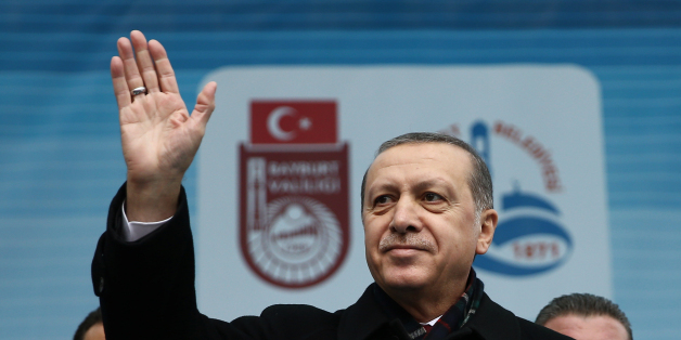 Turkey's President Recep Tayyip Erdogan addresses a rally in Bayburt, Turkey, Friday, Nov. 27, 2015. Russia announced Friday that it will suspend visa-free travel with Turkey amid the escalating spat over the downing of a Russian warplane by a Turkish fighter jet at the Syrian border. Erdogan refused to apologize for the plane's downing, which Ankara said came after it flew for 17 seconds into Turkish airspace. At the same timed, Erdogan said he has tried in vain to speak by phone to Putin to di