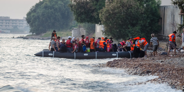 Early in the morning arrival Syrian refugees on the island of Kos in Greece