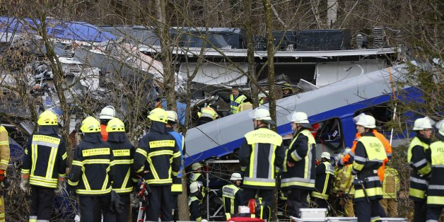 Rescue personnel stand in front of two trains that collided head-on near Bad Aibling, southern Germany, Tuesday, Feb. 9, 2016. Several people have been killed and dozens were injured. (AP Photo/Matthias Schrader)