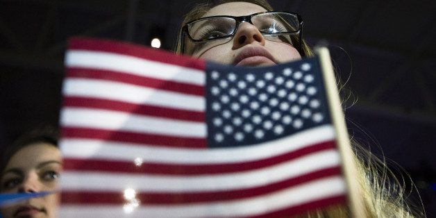An audience member listens as Democratic presidential candidate Sen. Bernie Sanders, I-Vt., speaks during a campaign stop at the University of New Hampshire Whittemore Center Arena, Monday, Feb. 8, 2016, in Durham, N.H. (AP Photo/John Minchillo)
