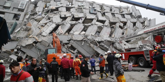 In this Saturday, Feb. 6, 2016 photo, rescue workers search a collapsed building from an early morning earthquake in Tainan, Taiwan. A powerful, shallow earthquake struck southern Taiwan before dawn Saturday. (AP Photo/Wally Santana, File)