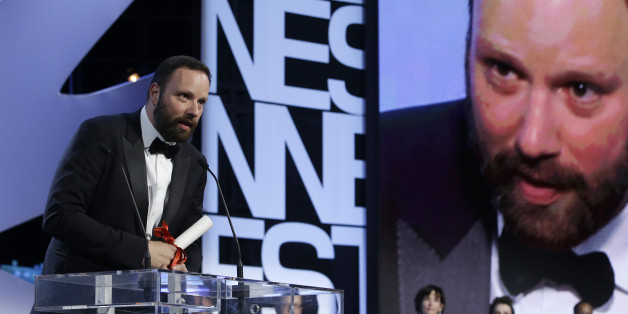 Director Yorgos Lanthimos speaks after he was presented the Jury Prize award for the film The Lobster during the awards ceremony at the 68th international film festival, Cannes, southern France, Sunday, May 24, 2015. (AP Photo/Lionel Cironneau)