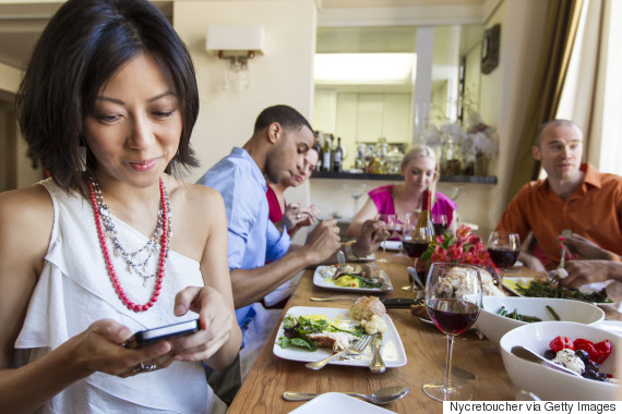 using phone at dinner