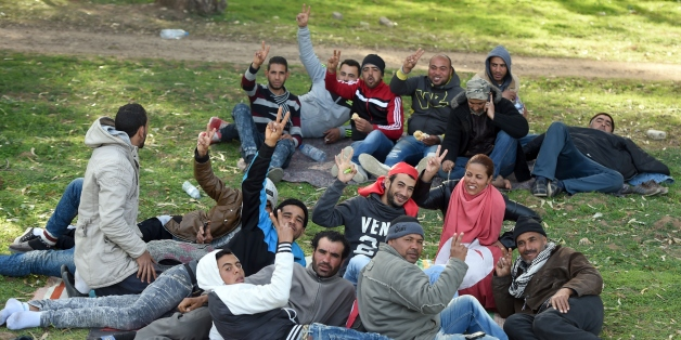 Unemployed Tunisians sit at el-Mourouj park after took part in a 400 kilometres march from the city of Gafsa to Tunis to demand work, on February 9, 2016, in the Tunisian capital.