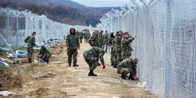 Macedonian soldiers build a second border fence to prevent illegal crossings by migrants at the Greek-Macedonian border near Gevgelija on February 8, 2016.