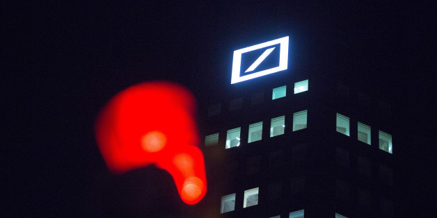 The Deutsche Bank AG, logo sits illuminated on the bank's headquarter offices at night in Frankfurt, Germany, on Wednesday, Jan. 27, 2016. German domestic demand, buoyed by a stable labor market and low oil prices, will propel the country's economic growth this year and compensate for slowing exports as emerging economies stumbles. Photographer: Krisztian Bocsi/Bloomberg via Getty Images