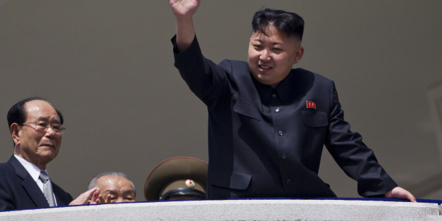 North Korean leader Kim Jong Un waves from a balcony at the end of a mass military parade in Pyongyang's Kim Il Sung Square to celebrate 100 years since the birth of his grandfather and North Korean founder Kim Il Sung on Sunday, April 15, 2012. North Korean leader Kim Jong Un delivered his first public televised speech Sunday, just two days after a failed rocket launch, portraying himself as a strong military chief unafraid of foreign powers during festivities meant to glorify his grandfather, North Korea founder Kim Il Sung. (AP Photo/David Guttenfelder)
