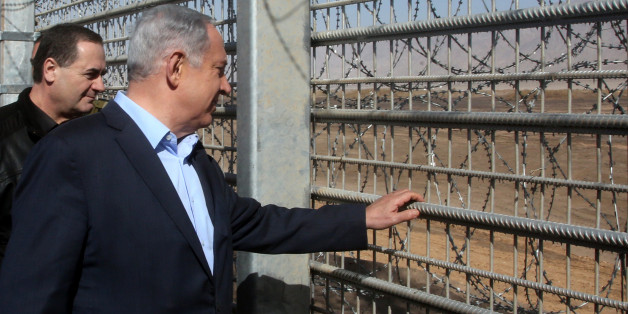 Israeli Prime Minister Benjamin Netanyahu visits the construction site of a new military border fence between Israel and Jordan, on February 9, 2016. Israel has begun construction on a security fence along its border with Jordan, the defence ministry announced, its latest such barrier intended to keep out illegal migrants and militants. The barrier will be 30 kilometres (19 miles) long between the resort city of Eilat and the site of the Sands of Samar and will cost 300 million shekels ($75 mill