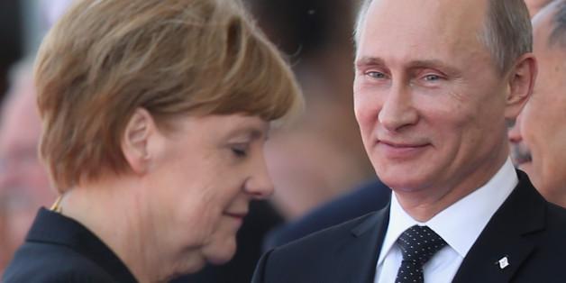 Der russische Präsident Wladimir Putin und Kanzlerin Angela Merkel